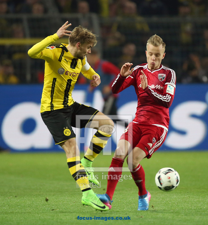 Marcel Schmelzer of Borussia Dortmund and Romain Bregerie of FC Ingolstadt 04 during the Bundesliga match at Signal Iduna Park, Dortmund<br /> Picture by EXPA Pictures/Focus Images Ltd 07814482222<br /> 17/03/2017<br /> *** UK &amp; IRELAND ONLY ***<br /> EXPA-EIB-170318-0041.jpg