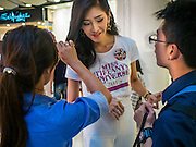 25 MARCH 2015 - BANGKOK, THAILAND: A contestant gets her hair and make up touched up during the first round of the Miss Tiffany's contest at CentralWorld, a large shopping mall in Bangkok. Miss Tiffany's Universe is a beauty contest for transgender contestants; all of the contestants were born biologically male. The final round will be held on May 8 in the beach resort of Pattaya. The final round is televised of the  Miss Tiffany's Universe contest is broadcast live on Thai television with an average of 15 million viewers.     PHOTO BY JACK KURTZ
