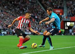 Southampton's Dusan Tadic is tackled by Stoke's Erik Pieters - Photo mandatory by-line: Dougie Allward/JMP - Mobile: 07966 386802 - 25/10/2014 - SPORT - Football - Southampton - ST Mary's Stadium - Southampton v Stoke - Barclays Premier League