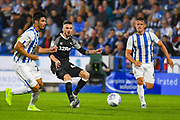 Scott Malone of Derby County (46) and Jonathan Hogg of Huddersfield Town (6) in action during the EFL Sky Bet Championship match between Huddersfield Town and Derby County at the John Smiths Stadium, Huddersfield, England on 5 August 2019.