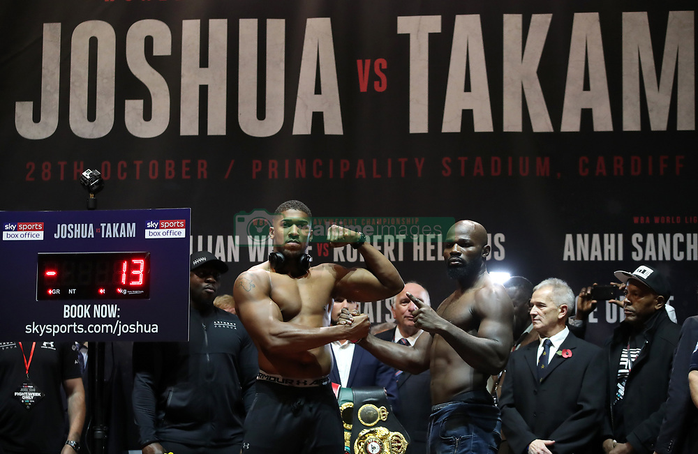 Anthony Joshua (left) and Carlos Takam during the weigh-in at Motorpoint Arena Cardiff.