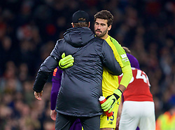 LONDON, ENGLAND - Saturday, November 3, 2018: Liverpool's manager Jürgen Klopp embraces goalkeeper Alisson Becker after the FA Premier League match between Arsenal FC and Liverpool FC at Emirates Stadium. The game ended in a 1-1 draw. (Pic by David Rawcliffe/Propaganda)