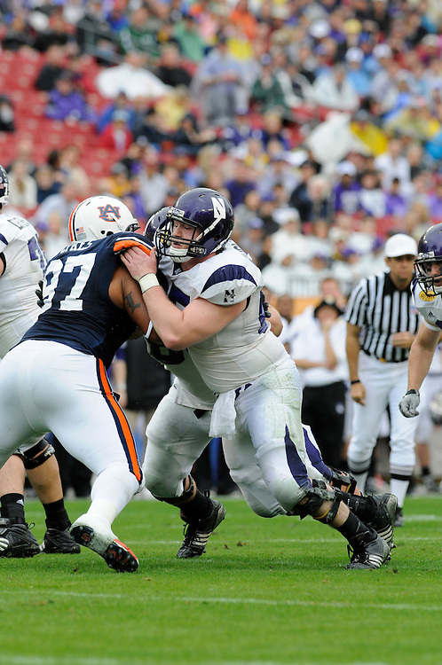 January 1, 2010: Ben Burkett of the Northwestern Wildcats in action during the NCAA football game between the Northwestern Wildcats and the Auburn Tigers in the Outback Bowl. The Tigers defeated the Wildcats 38-35 in overtime.