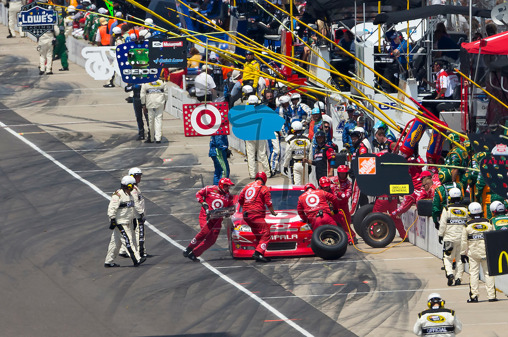 INDIANPOLIS, IN - JUL 29, 2012:  Juan Pablo Montoya (42) races during the Curtiss Shaver 400 presented by Crown Royal at the Indianapolis Motor Speedway in Indianapolis, IN.