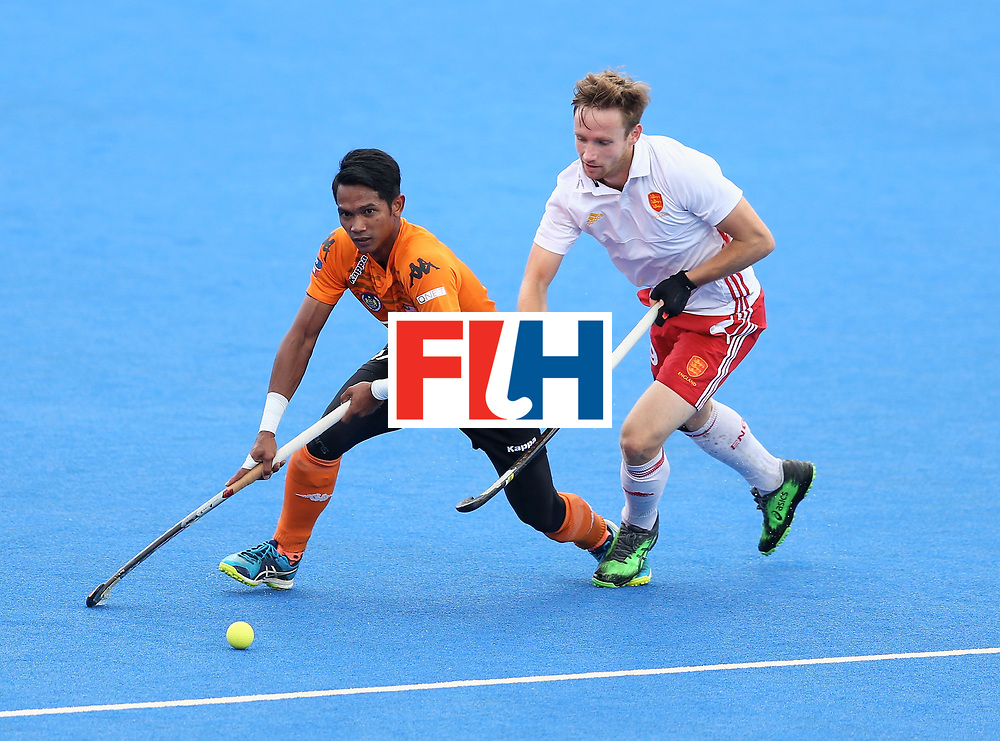 LONDON, ENGLAND - JUNE 25: Razie Rahim of Malaysia breaks away from David Goodfield of England during the 3rd/4th place match between Malaysia and England on day nine of the Hero Hockey World League Semi-Final at Lee Valley Hockey and Tennis Centre on June 25, 2017 in London, England. (Photo by Steve Bardens/Getty Images)