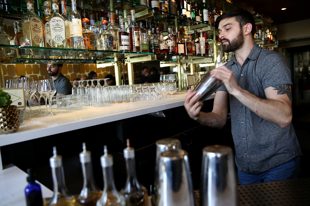 Emilio Salehi makes the Thunderbird drink at The Beehive, Saturday, May 5, 2018, in San Francisco, Calif. The Beehive is located at 842 Valencia Street.
