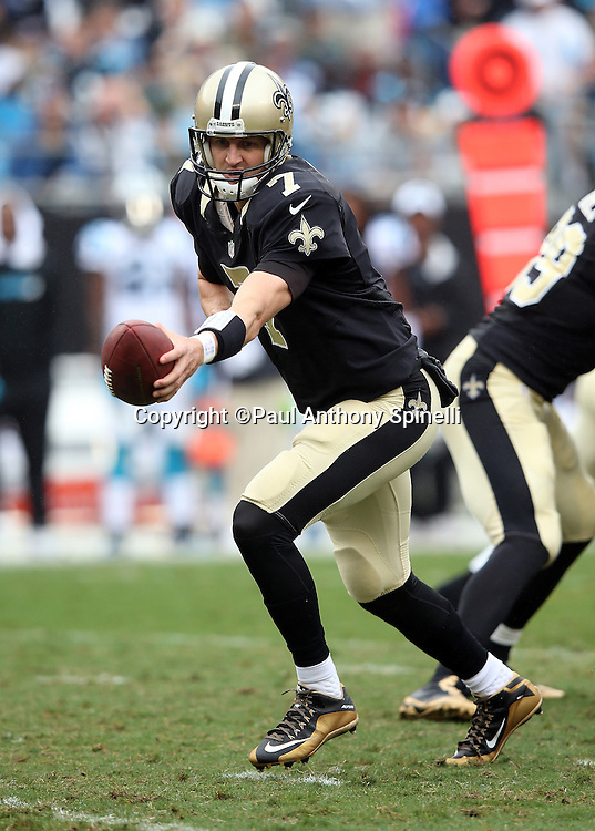 New Orleans Saints quarterback Luke McCown (7) hands off the ball on a running play during the 2015 NFL week 3 regular season football game against the Carolina Panthers on Sunday, Sept. 27, 2015 in Charlotte, N.C. The Panthers won the game 27-22. (©Paul Anthony Spinelli)