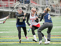 Laconia's Helen Tautkus charges through two Windham defenders during the girls lacrosse scrimmage on Saturday afternoon.(Karen Bobotas/for the Laconia Daily Sun)
