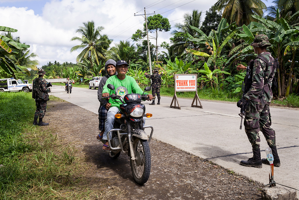 Kidapawan, Mindanao, Philippines - JUNE 20: Members of the Philippines Army conduct checkpoints at the entrance of Kidapawan City.  Security in the city is tight since President Duterte implemented a Martial Law for 60 days in Mindanao due to the heavy fighting in Malawi 250km away.