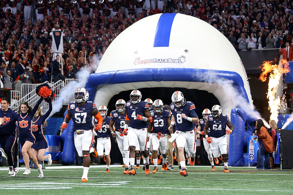 The Auburn Tigers run out of the tunnel prior to the 2018 Chick-fil-A Peach Bowl NCAA football game against the UCF Knights on Monday, January 1, 2018 in Atlanta. (Jason Parkhurst / Abell Images for the Chick-fil-A Peach Bowl)