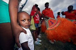 29 August 2015. Lower 9th Ward, New Orleans, Louisiana.<br /> Hurricane Katrina 10th anniversary memorials.<br /> Mourners gather at the levee to remember those who perished in the storm. <br /> Photo credit©; Charlie Varley/varleypix.com.