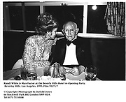 Randi White & Max Factor at the Beverly Hills Hotel re-Opening Party. Beverley Hills. Los Angeles. 1995. Film 95271/7<br />
