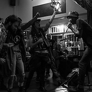 Pule is performing with his punk rock band, TCIYF, during a concert at a bar in Linden, an upmarket suburb in Johannesburg. TCYIF and the punk community of Soweto challenged the persisting racial and cultural barriers in South Africa, to reclaim a subculture originally associated to white people. Johannesburg. April 2017. © Miora Rajaonary / Native Agency