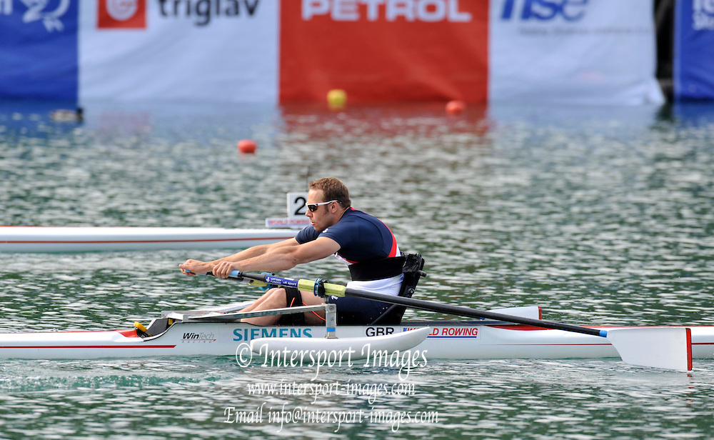Bled, SLOVENIA,   Adaptive Rowing, ASM1X, Andy HOUGHTON, moves  away from the start, in his semi final on the second day, FISA World Cup , Bled held on Lake Bled.  Saturday  29/05/2010  [Mandatory Credit Peter Spurrier/ Intersport Images] Cop last event as international level.