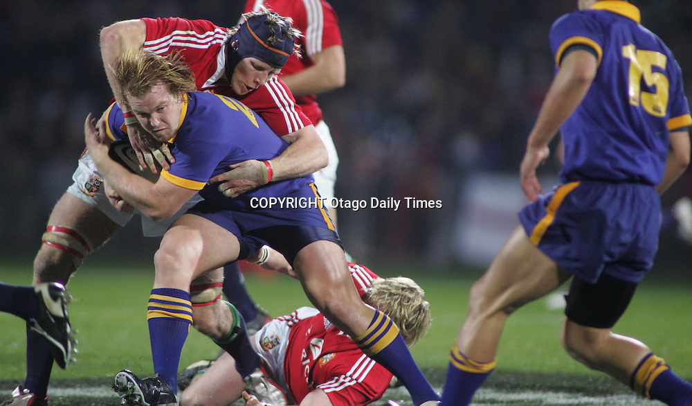 Otago Jason Shoemark tackled by Lions Simon Easterby <br />