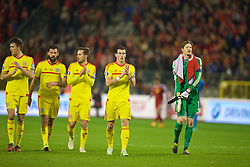 BRUSSELS, BELGIUM - Sunday, November 16, 2014: Wales' Emyr Huws, Joe Ledley, Aaron Ramsey, Gareth Bale and goalkeeper Wayne Hennessey celebrate a point and staying top of the group after the final whistle of a goal-less draw against Belgium during the UEFA Euro 2016 Qualifying Group B game at the King Baudouin [Heysel] Stadium. (Pic by David Rawcliffe/Propaganda)