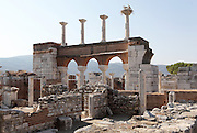 "Ruins of the Basilica of St John with the 2-storey narthex, built 536-565 AD under Emperor Justinian on the site of the apostle's tomb, Ephesus, Izmir, Turkey. St John the Evangelist spent his last years in Ephesus and died here. In the 4th century a church was erected over his tomb but in the 6th century Justinian ordered the construction of a large, 6-domed basilica built of stone and brick with marble columns in a Greek cross plan, the ruins of which we see today. The church measures 130x56m and was an important Christian pilgrimage site, attaining the status of ""Church of the Cross"". The domes were over the central crossing, choir, transepts and nave. Five domes rested on solid piers in the corners of the cross and surmounted the arms and centre crossing, held in place by massive marble pillars. Storks now nest on the capitals of the columns on the upper storey of the nave arcade or narthex, seen here. The church interior would have been covered with frescoes, and the vaults with mosaics. An earthquake in the 14th century destroyed most of the building. Ephesus was an ancient Greek city founded in the 10th century BC, and later a major Roman city, on the Ionian coast near present day Selcuk. Picture by Manuel Cohen"