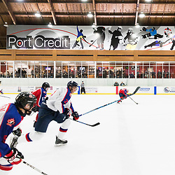 MISSISSAUGA, ON  - JAN 23,  2018: Canadian Junior Hockey League, Prospects Game 2018, players of CJHL Prospect Team East and CJHL Prospect Team West skate down the ice after the puck at Port Credit Memorial Arena.<br /> (Photo by Kevin Raposo / OJHL Images)