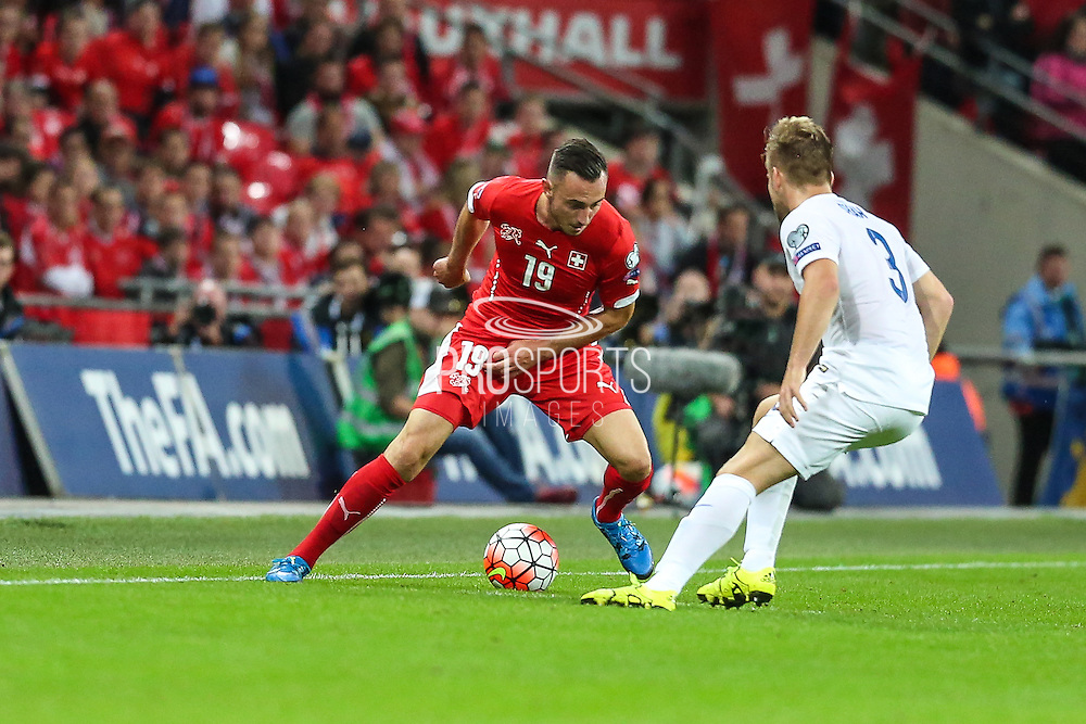 Switzerland's Josip Drmic takes on England's Luke Shaw  during the UEFA European 2016 Qualifying match between England and Switzerland at Wembley Stadium, London, England on 8 September 2015. Photo by Shane Healey.