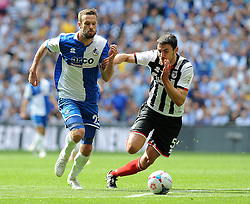 Bristol Rovers' Andy Monkhouse is challenged by Grimsby's Shaun Pearson - Photo mandatory by-line: Neil Brookman/JMP - Mobile: 07966 386802 - 17/05/2015 - SPORT - football - London - Wembley Stadium - Bristol Rovers v Grimsby Town - Vanarama Conference Football