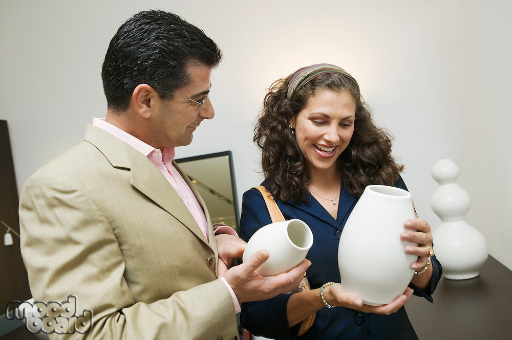 Couple Examining Vases