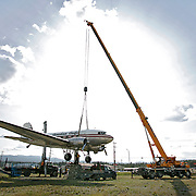Ian Stewart/Yukon News<br /> Whitehorse's famous Douglas DC-3 wind vane is prepped for relocation on Monday night. The vintage aircraft is being moved to the Yukon Transportation Museum, where it will be remounted once again.