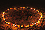 109 candles are to be burned in a large circle, which is a part of the Sasan Kali Spiritual Ritual, some of these candles are put in the Ganges. Here the Aghori Sadhu will pray to Kali. The nr 109 is also represented in the Shiva praying beads, a number for good Karma. Varanasi, India.