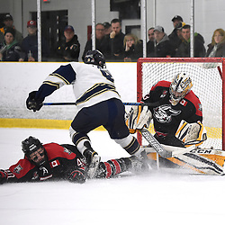 TORONTO, ON  - APR 10,  2018: Ontario Junior Hockey League, South West Conference Championship Series. Game seven of the best of seven series between Georgetown Raiders and the Toronto Patriots. Troy Timpano #33 of the Georgetown Raiders blocks the shot from Lee Lapid #8 of the Toronto Patriots during the first period.<br /> (Photo by Andy Corneau / OJHL Images)