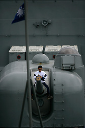 TAIWAN KEELUNG 3NOV07 - Navy cadet cleans bow gun on Taiwanese warship in the port of Keelung, northeast Taiwan...jre/Photo by Jiri Rezac..© Jiri Rezac 2007..Contact: +44 (0) 7050 110 417.Mobile:  +44 (0) 7801 337 683.Office:  +44 (0) 20 8968 9635..Email:   jiri@jirirezac.com.Web:    www.jirirezac.com..© All images Jiri Rezac 2007 - All rights reserved.