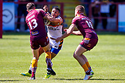 Bradford Bulls Johnny Campbell (19) is stopped in his tracks during the Kingstone Press Championship match between Batley Bulldogs and Bradford Bulls at the Fox's Biscuits Stadium, Batley, United Kingdom on 16 July 2017. Photo by Simon Davies.