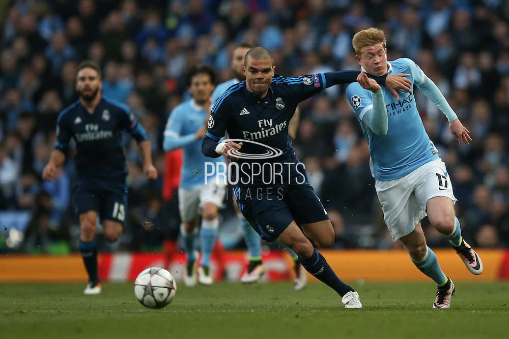 Manchester City midfielder Kevin De Bruyne (17) gets one in the throat from Real Madrid defender Pepe (3)  during the Champions League match between Manchester City and Real Madrid at the Etihad Stadium, Manchester, England on 26 April 2016. Photo by Simon Davies.
