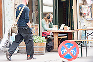 Street photography showing a resident relaxing at a cafe in Nørrebro, Copenhagen