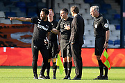 Derby County manager Phillip Cocu  and Derby County coach Liam Rosenior confront the match officials on the pitch after the EFL Sky Bet Championship match between Luton Town and Derby County at Kenilworth Road, Luton, England on 19 September 2020.