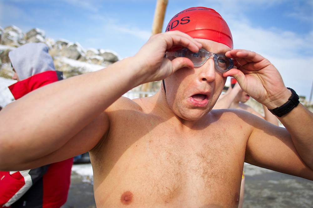 Gordon Gridley puts on his goggles before the New Year's Day Open Water Race at the Great Salt Lake Marina, Tuesday, Jan. 1, 2013. Gridley won the event with a time of 5:20.