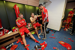 CARDIFF, WALES - Tuesday, October 13, 2015: Wales' Sam Vokes signs Hal Robson-Kanu's shirt in the dressing room after the 2-0 victory over Andorra during the UEFA Euro 2016 qualifying Group B match at the Cardiff City Stadium. (Pic by David Rawcliffe/Propaganda)