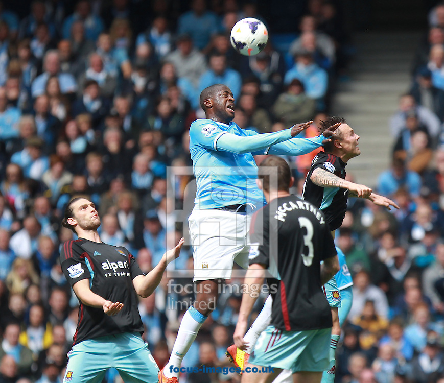 Yaya Toure of Manchester City gets above the West Ham United defence during the Barclays Premier League match at the Etihad Stadium, Manchester<br /> Picture by John Rainford/Focus Images Ltd +44 7506 538356<br /> 11/05/2014