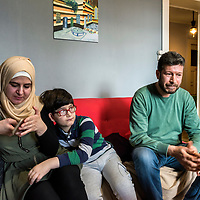 Syrian refugee couple, Mohamad Shakra and Sousan Alhumsi, from Ghouta, in their appartment in Lausanne, just after listening to her cousin, who was talking directly from a 'shelter' in Ghouta, where he is sheltering with his family and others, during a   bombardment. He has not been outside for 14 days.