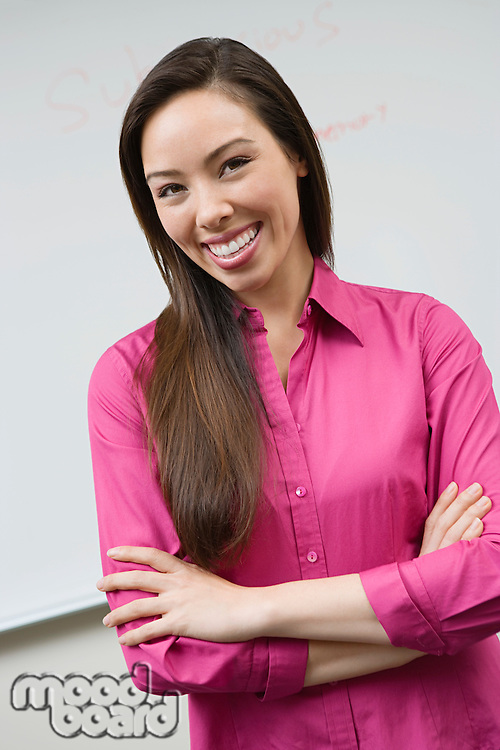 Business woman standing in front of whiteboard, portrait