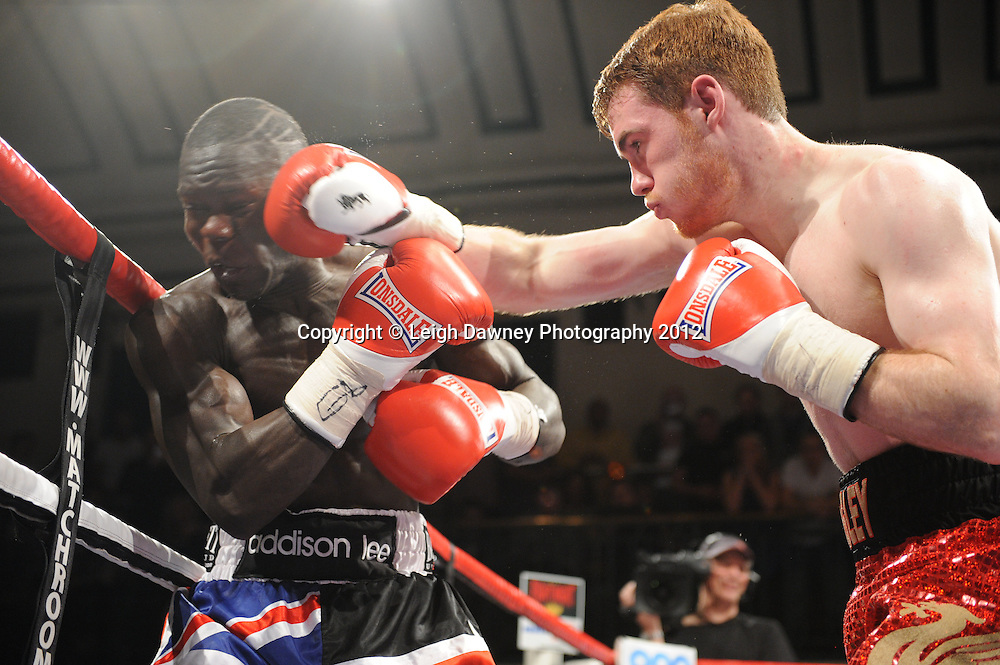 Eric Ochieng (Union Jack shorts) defeats Nick Quigley after his corner throw in the towel claiming The English Light Middleweight Title on the 28th January 2012 at York Hall, Bethnal Green, London. Matchroom Sport. © Leigh Dawney Photography 2012.