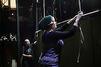 SLIEMA, MALTA - 8 FEBRUARY 2016: (L-R) Stage managers Dave McEvoy and Rebecca Austin set up the stage of the touring Hamlet performed by the Shakespeare's Globe theatre company at the Salesian Theatre in Sliema, Malta, on February 8th 2016.<br /> <br /> The touring Hamlet, performed by the Shakespeare's Globe theatre company, is part of the Globe to Globe tour that set off in April 2014 (on the 450th anniversary of Shakespeare's birth) with the ambitious intention of visiting every country in the world over 2 years. The crew is composed of a total of sixteen men and women: four stage managers and twelve twelve actors  actors perform over two dozen parts on a stripped-down wooden stage. So far Hamlet has been performed in over 150 countries, to more than 100,000 people and travelled over 150,000 miles. The tour was granted UNESCO patronage for its engagement with local communities and its promotion of cultural education. Hamlet was also played for many dsiplaced people around the world. It was performed in the Zaatari camp on the border between Syria and Jordan, for Central African Republic refugees in Cameroon, and for Yemeni people in Djibouti. On February 3rd it was performed to about 300 refugees in Calais at the camp known as the Jungle.