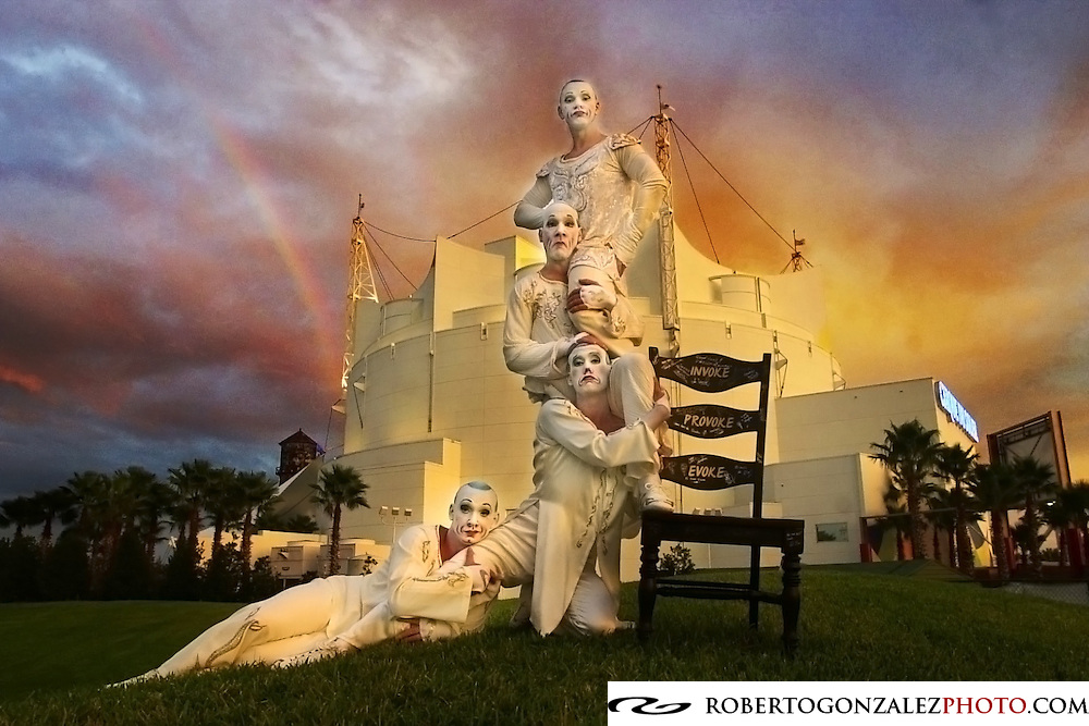 Cirque du Soleil performers Les Cons in Orlando pose with the chair that will be sold as part of the Robb & Stucky Charity, Monday, November 19, 2001.  Orlando Kissimmee