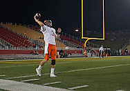 November 18, 2011: Oklahoma State Cowboys quarterback Brandon Weeden (3) warms up before the start of the NCAA football game between the Oklahoma State Cowboys and the Iowa State Cyclones at Jack Trice Stadium in Ames, Iowa on Friday, November 18, 2011. Iowa State upset Oklahoma State 37-31 double overtime.