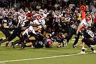 Junior Styles Hardamon (25) tackles senior Jalen Mack (32) as the Wayne Warriors play the Beavercreek High School Beavers at the Frank Zink Field in Beavercreek, Friday, October 7, 2011.