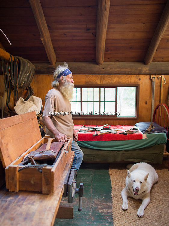 Robert Runyon looks through a box of antique hand tools at his home in Sugar Tree Hollow in Winslow, Arkansas, for Out Here Magazine. Photo by Beth Hall