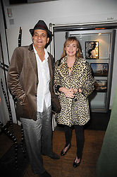 GERRY FOX and CLEMENTINE FRASER at a private view of Henry Brudenell-Bruce's work held at 269 Portobello Road, London, W14 on 24th November 2009.