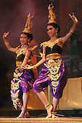 Two young women dancers clad in traditional Thai costumes are dancing during the annual Krabi Dance Festival in Krabi, Thailand.