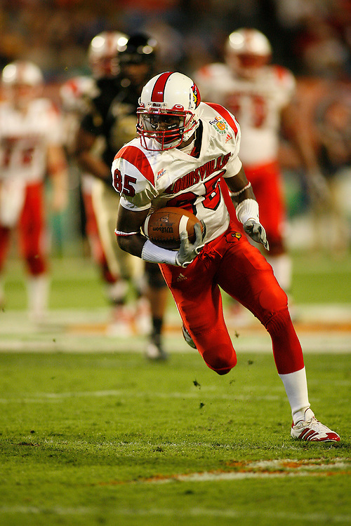 University of Louisville wide receiver Harry Douglas runs upfield after making a catch during the Louisville Cardinals 24-13 victory over the Wake Forest Demon Deacons at the 2007 Orange Bowl Game on January 2, 2007 at the Dolphin Stadium in Miami, Florida.