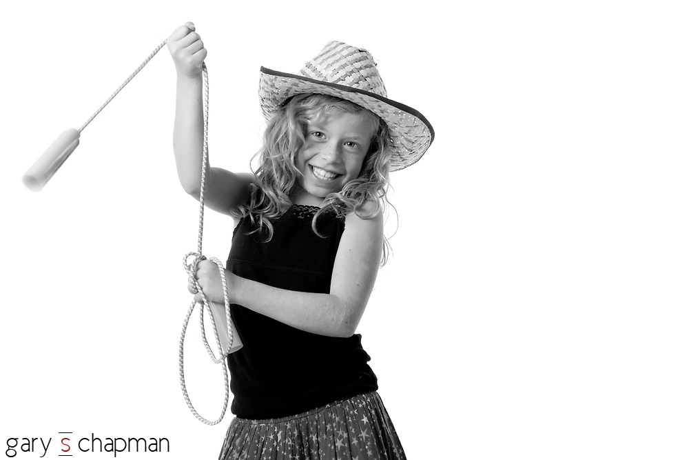 Nophia was a bundle of energy with her jump rope and cowgirl hat.