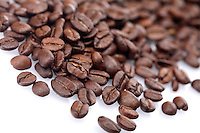 Rosted coffee grains on white backgorund