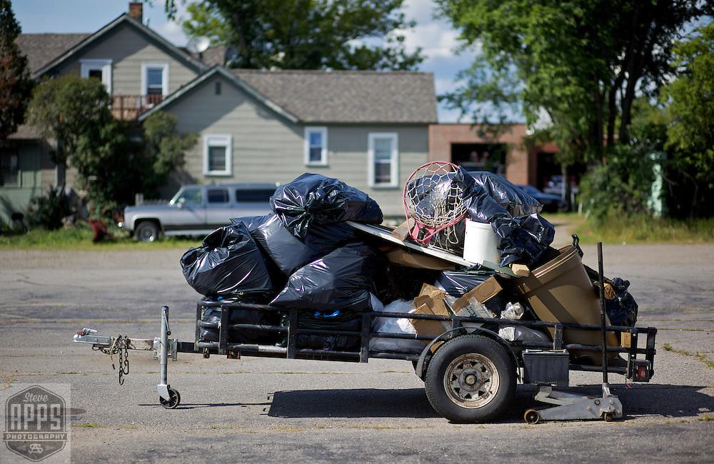 A trailor full of stuff in a parking lot in Rhinelander, Wisconsin.